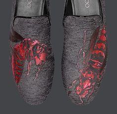Jimmy Choo's Sloane wasp velvet slippers.