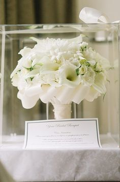The bride's stunning white bouquet of roses, calla lilies, dahlias and stephanotis is preserved until the next photo opp!