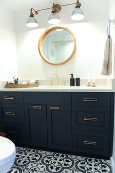 Black & white bath design with industrial elements including Grandview Triple Sconce by Rejuvenation