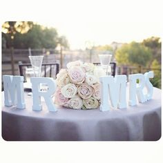MR & MRS + wedding flowers for table setting. This could be cute for the head table