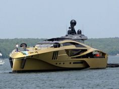 Gold makes everything better, right? That's what Palmer Johnson Yachts is counting on for their 48M SuperSport that was spotted cruising in the Sturgeon Bay shipping channel earlier this week. Sure, the luxury yacht looks like it is a spaceship or military craft from some angels, but in terms of design, it's actually pretty cool.