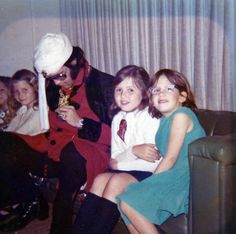 Elvis at Dave's Studio with his two daughters and friends; Elvis told David that he wore the tunic because He didn't have time to wash his hair :).