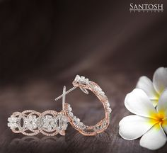 Make a fashion statement that leaves everyone around spellbound! Our specially designed loop earrings are for women who look for the extraordinary all the time!   Contact us at: info@santoshjewellers.in to get a quote or visit us at: http://santoshjewellers.in/  #diamondjewelry #diamondearrings #diamonds #UAE #Qatar #kuwait #oman #saudiarabia #bahrain #iran #tagforlikes #lovefordiamonds #fashion #luxury #highendjewelry #jewellery #style #jewelryporn #jewelporn #jewelrygram #jewelrydesign #je