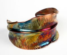 Copper Cuff Bracelet, A Rustic Forged, Fold Formed and Hammered Copper Leaf Cuff With Colorful Heat Patina- Leaf In Transition by FEBRAROSE on Etsy.  Oh my, such beautiful colors!!