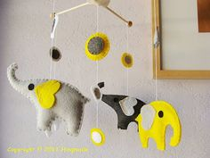 Gray and Yellow elephant mobile. Going to try to make this!
