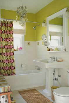 clever shelf built-in to mirror frame.  and the yellow is really cheerful!