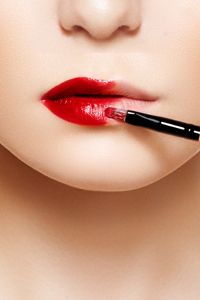 """A good red lip can make your whole face look """"done"""" -- even when it's the only makeup you're wearing."""