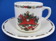 This is an ironstone Christmas cup and saucer in a holiday design with a rocking horse, Christmas tree and toys. The design is called O'Christmas Tree and was made by Ten Strawberry Street, Ltd. in Ch