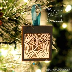 Make this handmade fingerprint christmas ornament! Tracie from Cleverly Inspired shows us how! -- Tatertots and Jello HAPPY Holidays