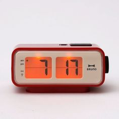 The timeless flip clock made DIGITAL! This compact alarm clock is perfect for any nightstand and illuminates with the push of a button. The battery powered clock comes in three different colorways, all have a sense of nostalgia. Fully digital, the changin Retro Radios, Clock Orange, Flip Alarm Clock, Alarm Clocks, Bedroom Clocks, Look Vintage, Digital Alarm Clock, Techno, Old Things