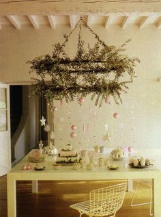 I would love to have one of these tiered chandeliers anyway - plus you can festoon like so for the holidays