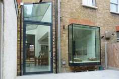 Large pivot door, glass roof and oriel bay window. Side Return Extension, Glass Extension, Extension Plans, Rear Extension, Pivot Doors, Sliding Doors, Window Types, Traditional Doors, Roof Light