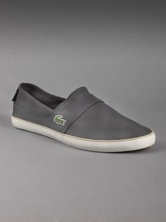 Lacoste® Men's Marice Canvas Sneaker in Dark Grey.  If  you're a guy on the go and like to keep it casual, slip into these  canvas dark grey sneakers. Features the signature croc logo embroidered  on the side and the Lacoste name stitched on the heel.