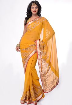Yellow faux chiffon zari and patch border saree. Matching blouse is available with this, blouse shown in this image is photography purpose. (Slight variation in color and patch border is possible.) data-pin-do=