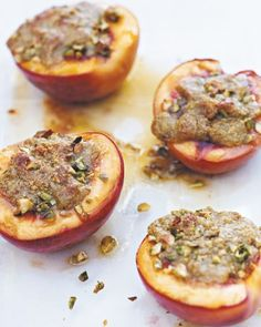 You can enjoy stone fruits now, coaxing even firm nectarines to tenderness by baking them. With each spoonful of this simple dessert, a rich, crunchy pistachio topping gives way to soft, juicy fruit. Recipe: Baked Nectarines with Pistachios Pistachio Recipes, Fruit Recipes, Dessert Recipes, Cooking Recipes, Dessert Ideas, Paleo Recipes, Nectarine Dessert, Delicious Desserts, Gourmet