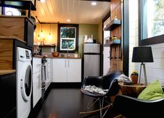 A custom tiny house with roof deck built by Heirloom Tiny Homes in Oregon City, Oregon.