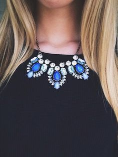 This, black shirt, blue shorts, silver/black sandals or wedges.