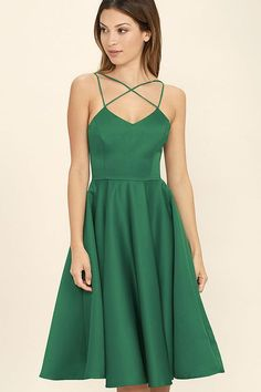 A love that lasts forever starts with the Neverending Story Green Midi Dress! Medium weight, woven poly has a slight sheen as it shapes a princess seamed bodice supported by crisscrossing straps. Midi skirt flares from a fitted waist. Hidden back zipper/clasp.