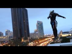 Parkour, real cool and something I would love to do.  Assassin's Creed 4 Parkour Entrance at Comic-Con with Devin SuperTramp