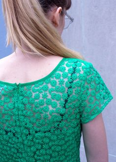 50's inspired dress with green flower pattern embroidery. Solid sweetheart neckline and semi-sheer top.