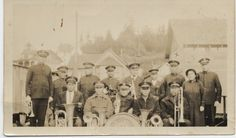 B&W photo (poor quality) of the Congress Band, Klawock, Alaska, Nov. The group is standing/sitting in front of living quarters with their musical instruments. Classic Army, Musical Instruments, Alaska, Musicals, Group, Band, Collection, Music Instruments, Sash