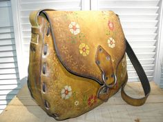 HAND PAINTED & TOOLED Vintage 70s Brown Floral by ManeaterVintage, $68.00 vintage fashion vintage shopping hand tooled leather shoulder bag crossbody festival purse flowers florals hippie boho bohemian worn broken in leather