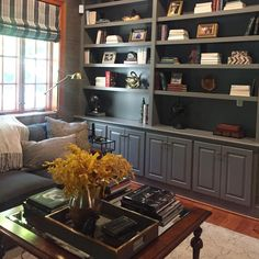 I spent the afternoon styling these bookshelves and coffee table for a dear sweet client.... (bottom shelves will get some fall decor).... whole room will get photographed soon! #amyspearinginteriors #rva #richmond #interiordesign #interiordesigner #homedecor #mancaveproject #masculineden #books #bookshelves #decoratingwithbooks #coffeetable #coffeetablestyling #romanshades #graylivingroom
