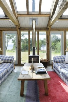 Living room with vaulted glazed ceiling and fully glazed walls in contemporary oak framed new build house in Scotland Barn Living, Home And Living, Living Area, Living Spaces, Living Room, Oak Framed Extensions, Kitchen Extensions, Atrium, Best Interior