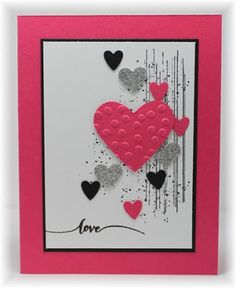 The card - just a little grunge in the background and some punched hearts - pretty darn easy.Another baby shower this af...