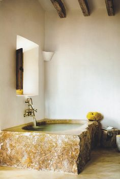 Such a pretty bath. Love the rough hewn edges, with the high polished top & bowl. And so many possibilities too. Maybe a limestone? Ooh, exciting.