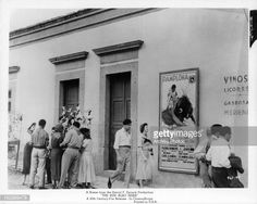 People walk past an advertisement for a bull fight in a scene from the film 'The Sun Also Rises', Get premium, high resolution news photos at Getty Images The Sun Also Rises, Walk Past, Pamplona, Advertising, Walking, Scene, News, Film, People