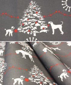This holiday fabric by New Mom Designs playfully depicts a hardworking team of dogs preparing for the holidays.