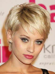 Pixie cut looks great on her with fair skin red lips and blonde hair very feminine i love it!
