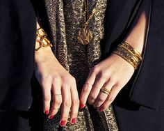 gold jewelry, red nails