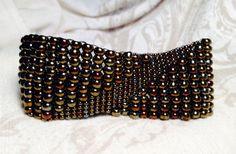 Iris bronze seed bead woven bracelet. Geometric pattern. Brown iris