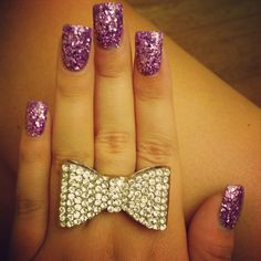 I love the purple, I love bows, I love glitter and I love giant rings!