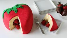"""""""Strawberry Surprise Cake"""" -- Click through for step-by-step photos and instructions for this """"strawberry-shaped piñata-style version [of strawberry shortcake] with fresh strawberries hiding inside"""" made for """"Tablespoon"""" by the incredibly talented Beth of """"Hungry Happenings."""" She gives a frosting and a fondant option, plus lots of tips."""