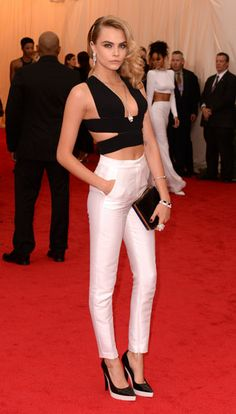 Cara Delevigne steers away from the dress code in a cutout top and pants by Stella McCartney at the Met Gala 2014.