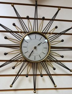 Such a cool piece! Add the perfect vintage touch to any room! Overall in excellent working condition. This clock is battery operated. Made by Sterling and Noble. Measures 18across at widest part.  Please let us know if you have any questions! Thanks for looking