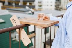 Skydeck, a small table which is made to hook onto handrails of balconies or lookout points.