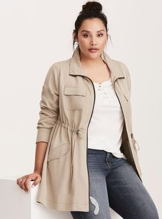 """How to look like one of those chic Parisian girls without actually being from France: this jacket. Inspired by trench dressing, the tan twill is utility-esque with a zip front accompanying the draped style. Silky to the touch, the look gets even more """"touch me"""" with an adjustable tie waist and utility-inspired pockets.<div><br></div><div><b>Model is 5'10"""", size 1<br></b><div><ul><li style=&q..."""