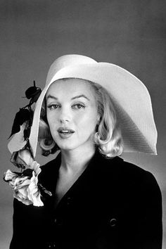 NOVEMBER 1960 – Sporting a very different look to her traditional glamour, the actress in a conservative black coat and floppy hat.  Marilyn Monroe Style and fashion pictures (Vogue.com UK)