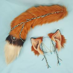 I just spent all weekend putting together this pretty boho inspired fox set and I'm super excited to share it with you guys! I'm going to be putting this one up for auction starting at a lower price then I would actually list it for. It is going to be up for three days and the link will be in my bio  All of the braided parts are real leather (everything else is still faux fur). The tail is 25 inches long and the chain is fully detachable. The ears are 3 inches tall poseable and adjustable…