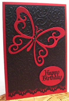 handmade birthday card from Jenfa Cards: Moulin Rouge Butterfly ... luv the huge red die cut butterfly ... black background richly textured with embossing folder design ... red + black = wow!!!