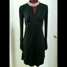 BCBGMAXAZRIA black dress Pretty & comfortable long sleeve dress by BCBGMAXAZRIA size xxs. Jersey material has stretch and can fit an xs (which is what I normally wear). Very good condition - no rips, stains, or fading. Dress length is 34 inches.   Open to offers :) No trades or PayPal. Happy Poshing! BCBGMaxAzria Dresses