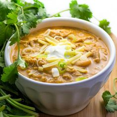 The best White Chili Ever! Tender shredded chicken and white beans simmered in the most delicious spicy creamy chili sauce!