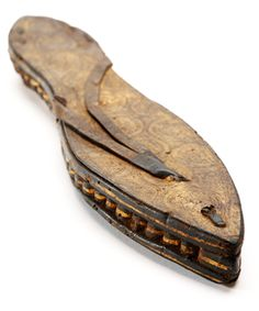 """Sandal, Egypt, ca. 30 BC - AD 300 A tanned leather and papyrus sandal with gilding, carving, incising, dyeing and punchwork. """"What goes arou..."""
