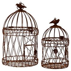 Set of two wire birdcages with finial accents.   Product: Small and large birdcage  Construction Material: Metal