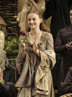 Sansa Stark in one of her Northern gowns. I much prefer these (particularly this one!) to the Southern styled ones - minus Cersei's. Her hair is just darling too.