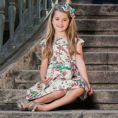 Girls smart floral jacquard dress by Patachou. The bodice is fitted and has a dropped waist, with a pleated skirt and the full lining has a net trim at the hem, forming a stiff petticoat. There are small capped sleeves and a concealed back zip fastening.